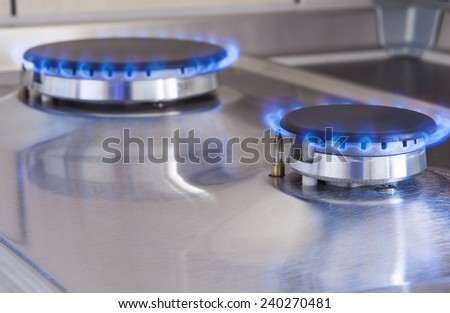 Closeup Shot of Two Gas Burners In Line Located on Kitchen Stove. Horizontal Image Composition - stock photo