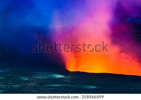 Closeup shot of volcanic eruption at night with small steaming vents on Big Island, Hawaii
