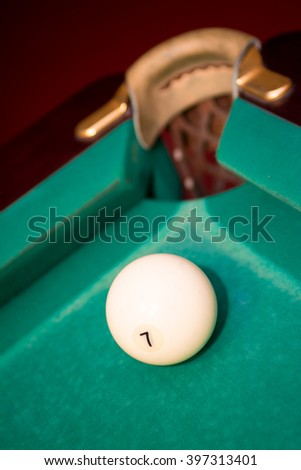 Closeup shot of white ball going in pocket