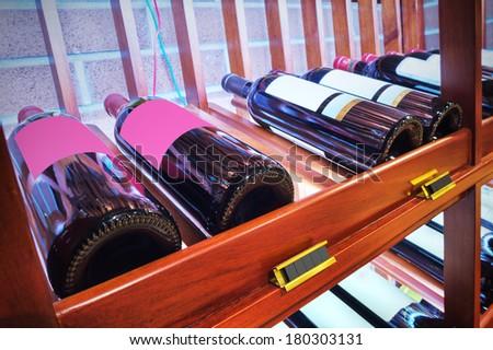 Closeup shot of wineshelf - stock photo