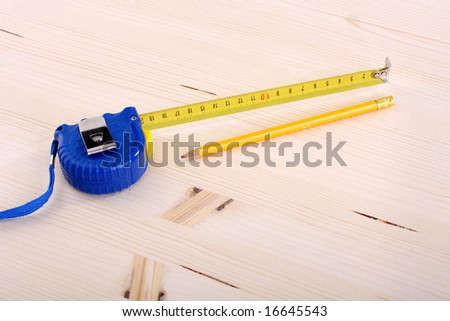 closeup shot of wooden plank and measuring tape