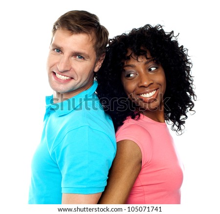 Closeup shot of young attractive couple posing back to back - stock photo