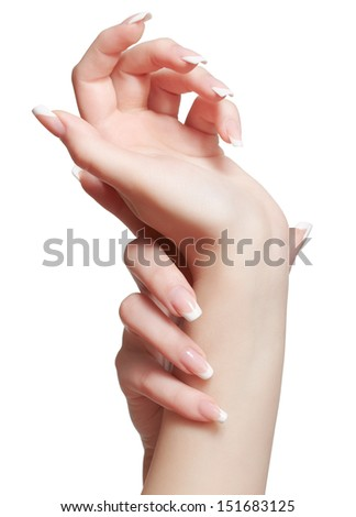 closeup shot of young woman's healthy hands with manicure on white - stock photo