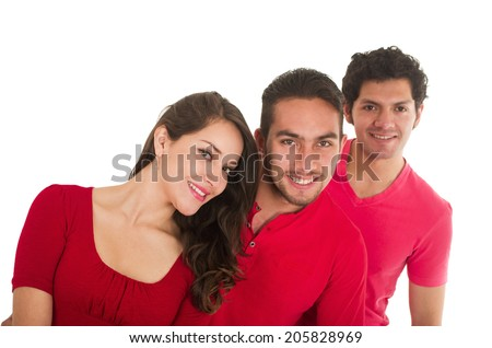 closeup shot two young men and a young girl smiling dressed in red posing isolated on white