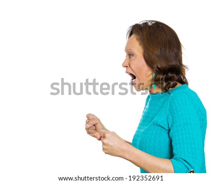 Closeup side portrait, headshot mad, angry, hostile, senior woman, worker, furious employee, yelling, hands, open mouth, isolated white background. Negative human emotion, facial expression, reaction - stock photo