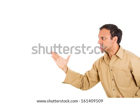 Closeup side profile portrait of angry man about to karate chop someone with hand, isolated on white background with copy space. Negative human emotion facial expressions - stock photo