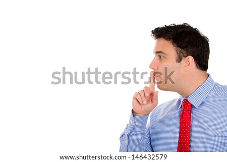 Closeup side profile portrait of handsome businessman putting fingers on lips, to say shh, isolated on white background with copy space - stock photo