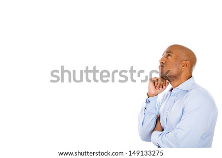 Closeup side profile portrait of handsome guy thinking with fist under chin, isolated on white background with copy space - stock photo