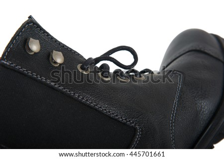 Closeup side view of high black men's boots isolated on a white background