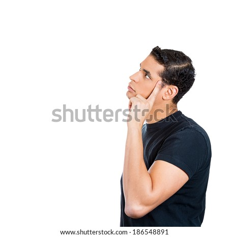 Closeup side view portrait, handsome young man, guy, student, employee, worker thinking, daydreaming, wondering, hand on face, isolated on white background. Human face expression, emotions, reaction - stock photo