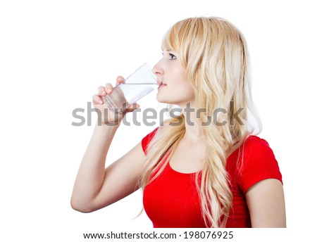 Closeup side view portrait headshot young beautiful, blonde woman drinking water from glass isolated white background with copy space. Healthy life style body care hydration concept. Facial expression - stock photo
