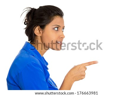 Closeup side view portrait of young unhappy, serious woman pointing at someone as if to say you did something wrong, bad boy, isolated white background. Negative emotions, facial expressions, feelings - stock photo
