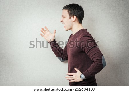 Closeup, side view profile portrait angry man with hands in air, wide open mouth yelling, isolated gray background. Negative emotion, facial expression feelings. Conflict scandal problems - stock photo