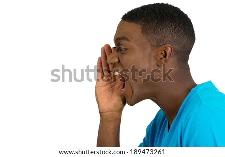 Closeup side view profile portrait, angry upset young man, worker, business employee, hand to open mouth yelling, isolated white background. Negative human emotion facial expression feeling - stock photo
