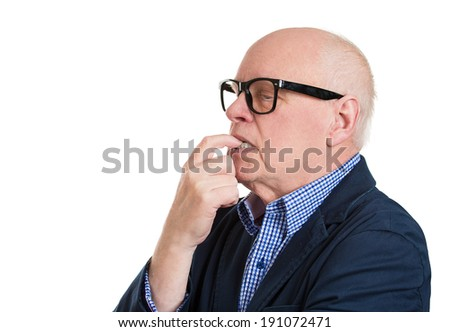 Closeup side view profile portrait, headshot senior mature man, finger in mouth, sucking, biting fingernail, deep in thought, isolated white background. Negative emotion, facial expression, feelings - stock photo