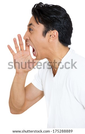 Closeup side view profile portrait of angry guy, upset young man, worker, employee, business man, hand to open mouth yelling, isolated on white background. Negative emotion facial expression emotion - stock photo