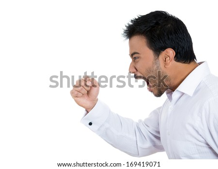 Closeup side view profile portrait of angry upset young man, worker, business employee,putting up fist in threatening fashion, isolated on white background. Negative  emotion facial expression feeling - stock photo