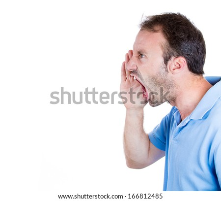 Closeup side view profile portrait of angry upset young man, worker, employee, business man hand to open mouth yelling, isolated on white background. Negative  emotion facial expression emotion