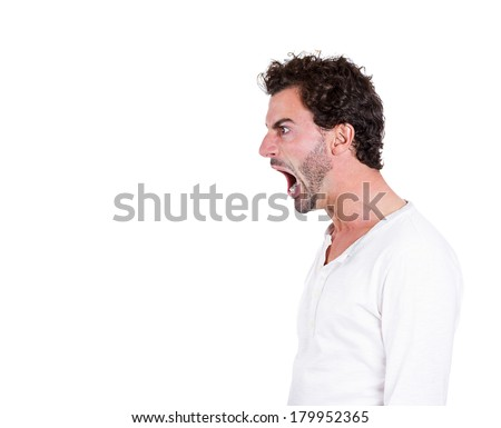 Closeup side view profile portrait of angry upset young man, worker, employee, business man with wide open mouth, yelling isolated on white background. Negative emotions, facial expressions, reaction - stock photo