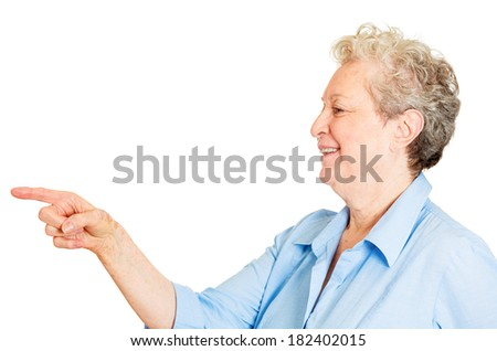 Closeup side view profile portrait of senior mature woman laughing pointing finger at someone or something, isolated white background. Positive emotion facial expression feelings, attitude, reaction - stock photo