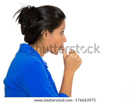 Closeup side view profile portrait of woman with finger in mouth, sucking thumb, biting fingernail in stress, deep thought, isolated on white background. Negative emotion, facial expression, feelings