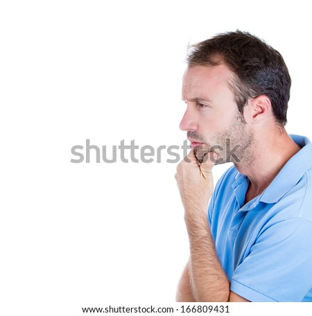 Closeup side view profile portrait of young man daydreaming deeply about something with chin on hand looking upwards, isolated on white background, space to left. Emotion facial expressions feelings