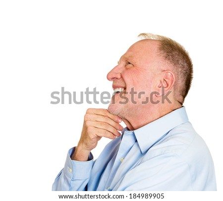 Closeup side view profile portrait, senior mature man, daydreaming about something that makes him happy, looking up, isolated white background. Positive human emotion facial expression feelings. - stock photo