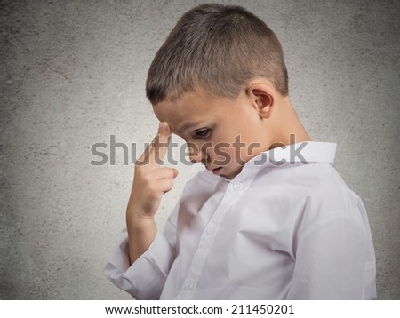 Closeup side view profile portrait young man, boy thinking, solving a problem, isolated grey wall background. Human face expressions, emotions, body language. Education, intelligence concept. - stock photo