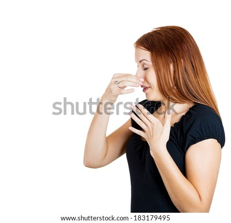 Closeup side view profile portrait young woman,disgust on face, pinches nose, something stinks, very bad smell, situation, isolated white background. Negative human emotion facial expression feeling - stock photo