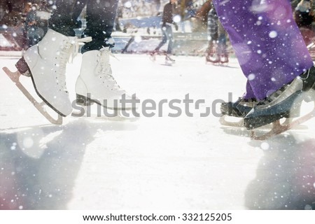 Closeup skating shoes ice skating outdoor at ice rink. Magical glitter of snowy snowflakes and bokeh. Healthy lifestyle and winter sport concept at sports stadium. - stock photo