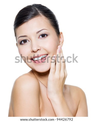 Closeup smiling face of a beautiful young asian woman - on white background - stock photo