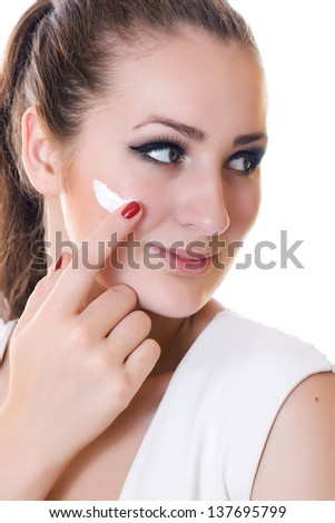 Closeup smiling woman portrait with cream on face over white background