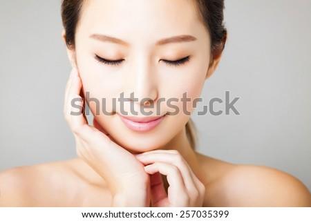 closeup smiling young  beautiful asian woman face  - stock photo