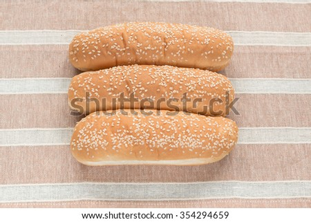 closeup  soft bread with sesame seed  on brown clothes