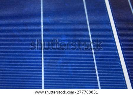 Closeup Solar panel produces green, environmentally friendly energy from the sun - stock photo