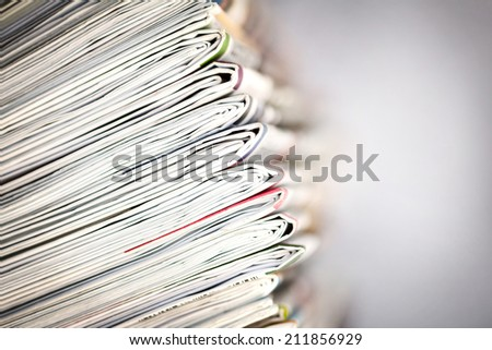 closeup stack of newspaper - stock photo