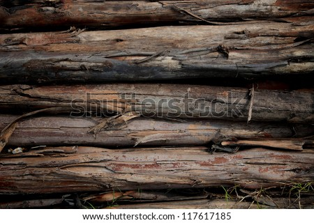 Closeup stack of old dark wooden logs - stock photo