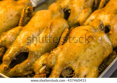 closeup steamed duck in the black sauce ready to eat - stock photo