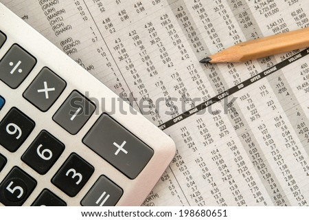 closeup stock and financial on newspaper - stock photo