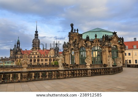 Closeup stone figure and Residenzschloss (city hall) on the back at Zwinger palace in Dresden, Germany  - stock photo