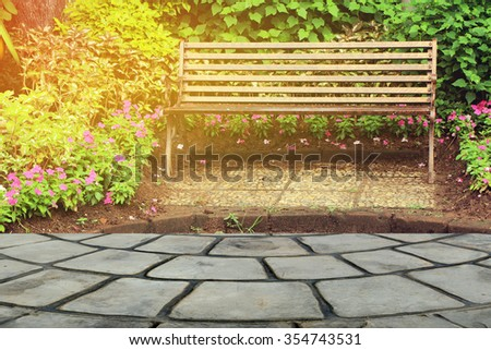 closeup stone floor with old seat in public park background - stock photo