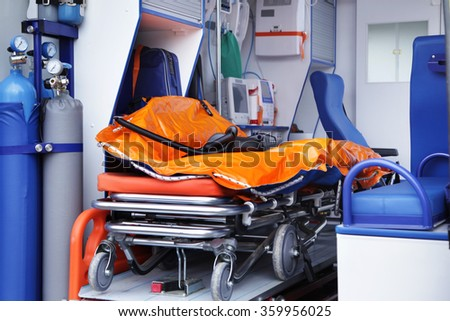 Closeup stretcher and medical equipment inside in ambulances - stock photo