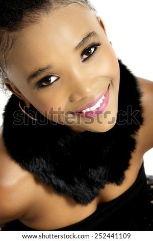 Closeup Studio Photo of Beautiful African Female Model in Modern Black Dress with Black Scarf, on White Background - stock photo