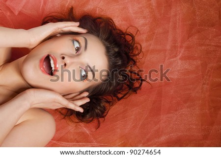 Closeup studio portrait of a beautiful girl with the emotion of surprise - stock photo