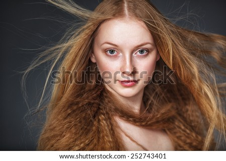 closeup studio portrait of woman with flying hair - stock photo