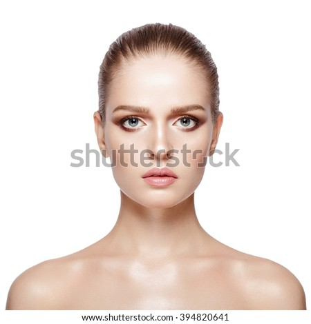 Closeup studio portrait of young attractive model with professional makeup on white background. Perfect skin. Blue eyes. Brunette. Isolated - stock photo