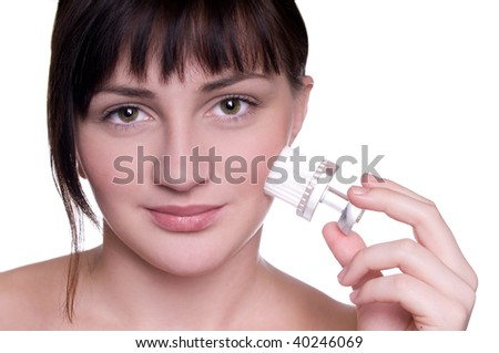 Closeup studio shot of a young beautiful woman cleaning face