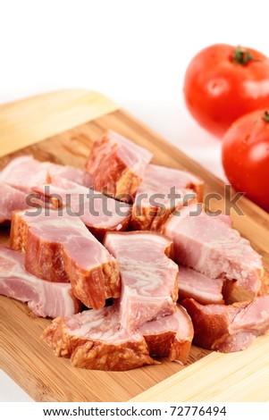 Closeup studio shot of sliced smoked bacon - stock photo