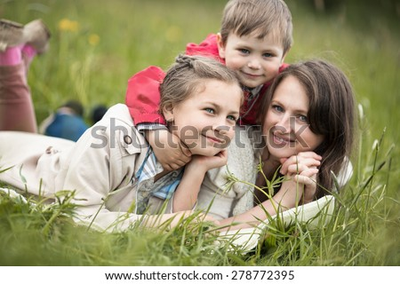 closeup summer portrait of happy Family  relaxing in countryside - stock photo