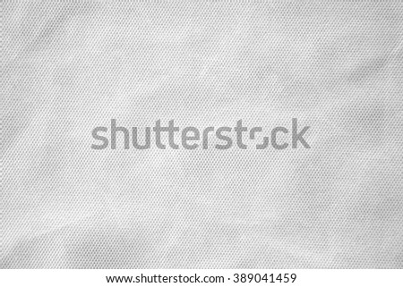 Closeup surface detail of abstract old crumpled white fabric texture background - stock photo